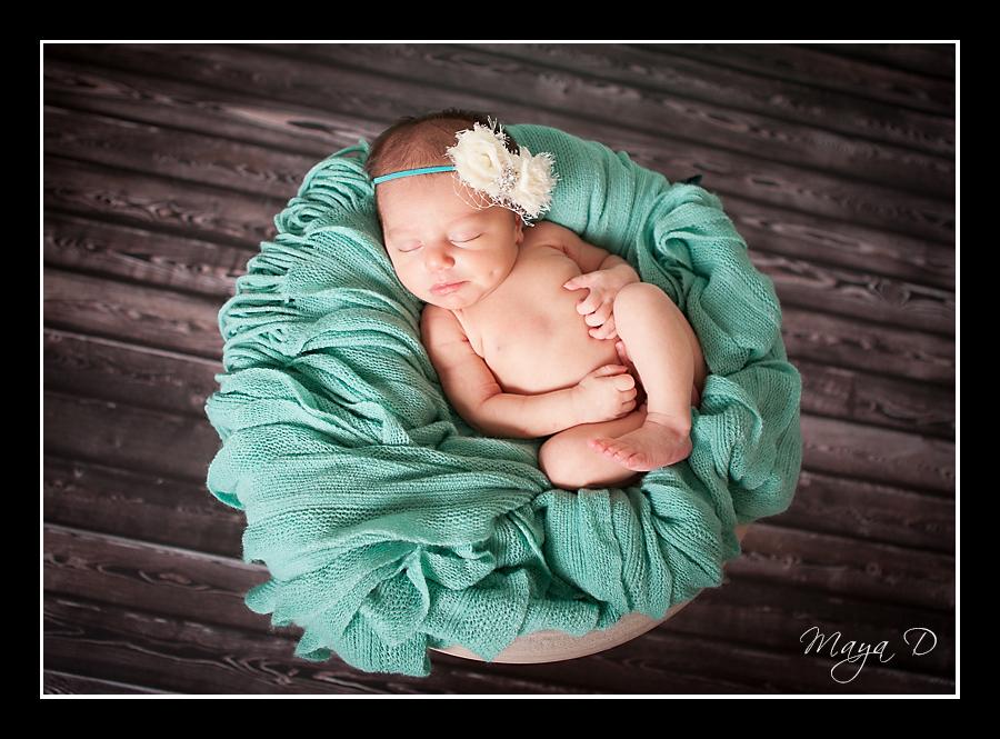 newborn in basket
