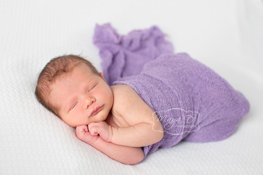baby girl wrap in purple fabric