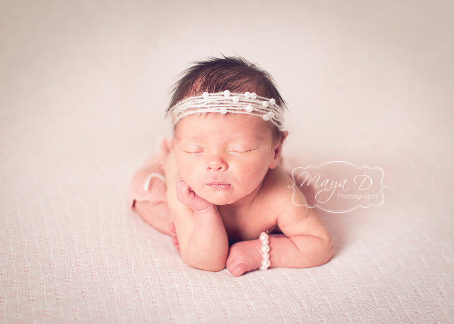 newborn hand on cheek pose