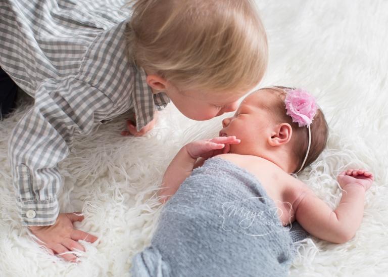 newborn and sibling love