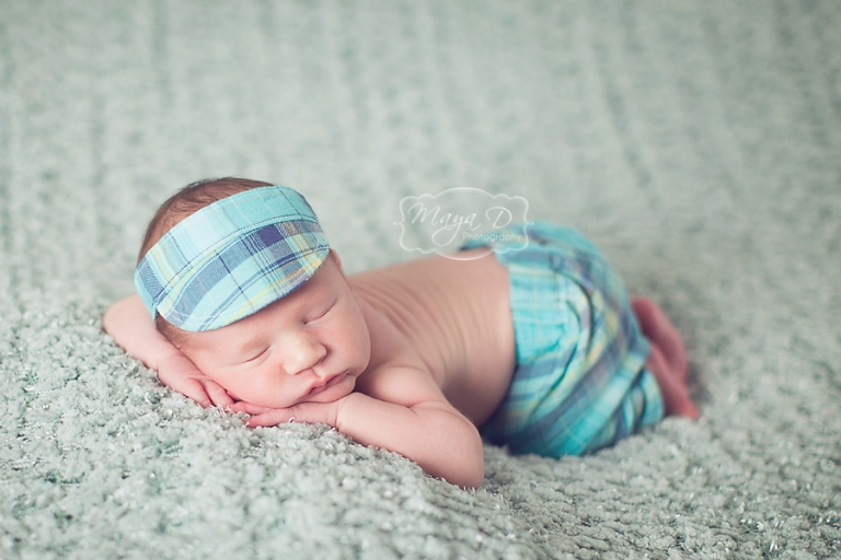 baby with pants and visor